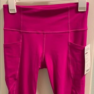 Athleta Stash Pocket Salutation Tight